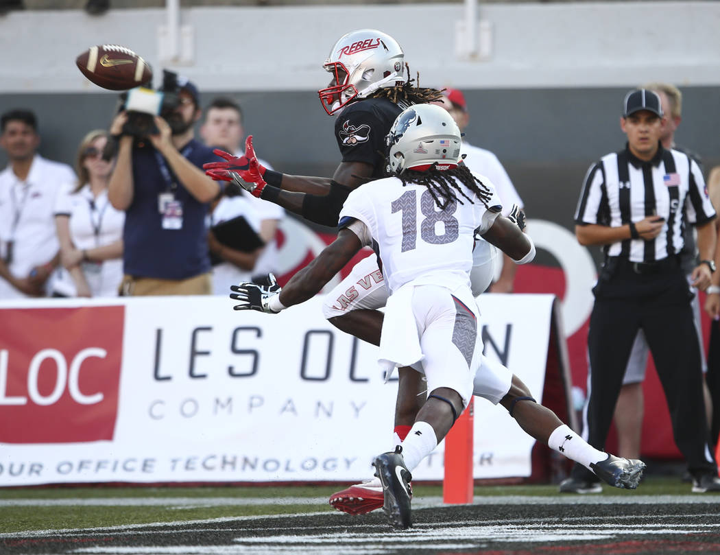 Howard defensive back Travon Hunt (18) breaks up a pass intended for UNLV wide receiver Devonte Boyd during a football game at Sam Boyd Stadium in Las Vegas on Saturday, Sept. 2, 2017. Chase Steve ...