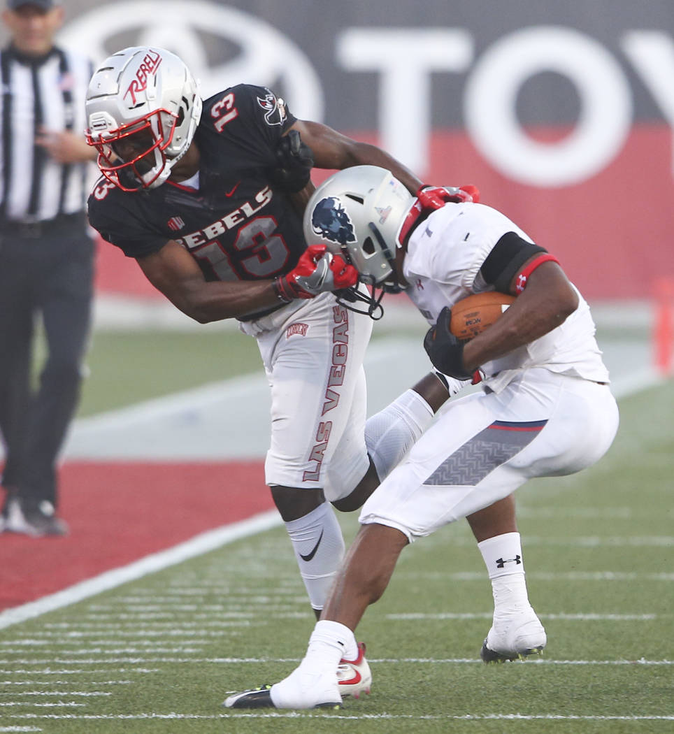 Howard running back Anthony Philyaw, right, is tackled by UNLV defensive back Tim Hough (13) during a football game at Sam Boyd Stadium in Las Vegas on Saturday, Sept. 2, 2017. Chase Stevens Las V ...