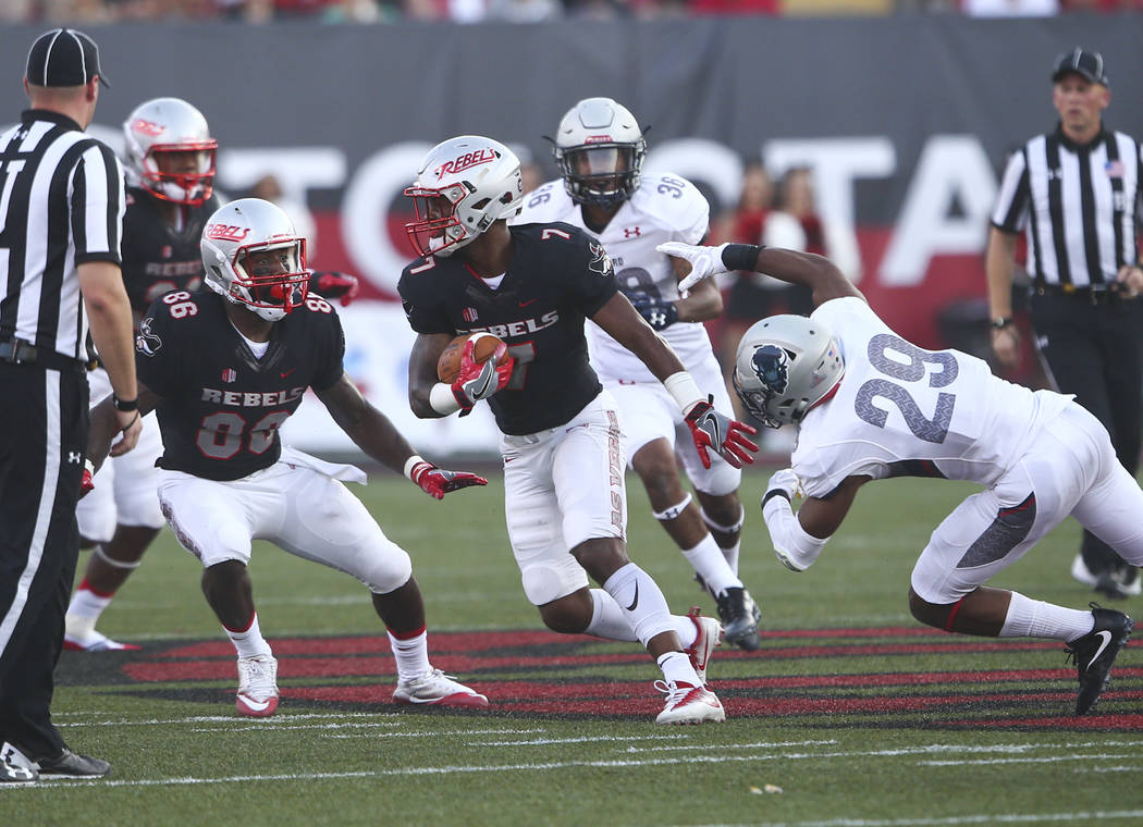 UNLV wide receiver Jericho Flowers (7) runs the ball against Howard during a football game at Sam Boyd Stadium in Las Vegas on Saturday, Sept. 2, 2017. Chase Stevens Las Vegas Review-Journal @csst ...