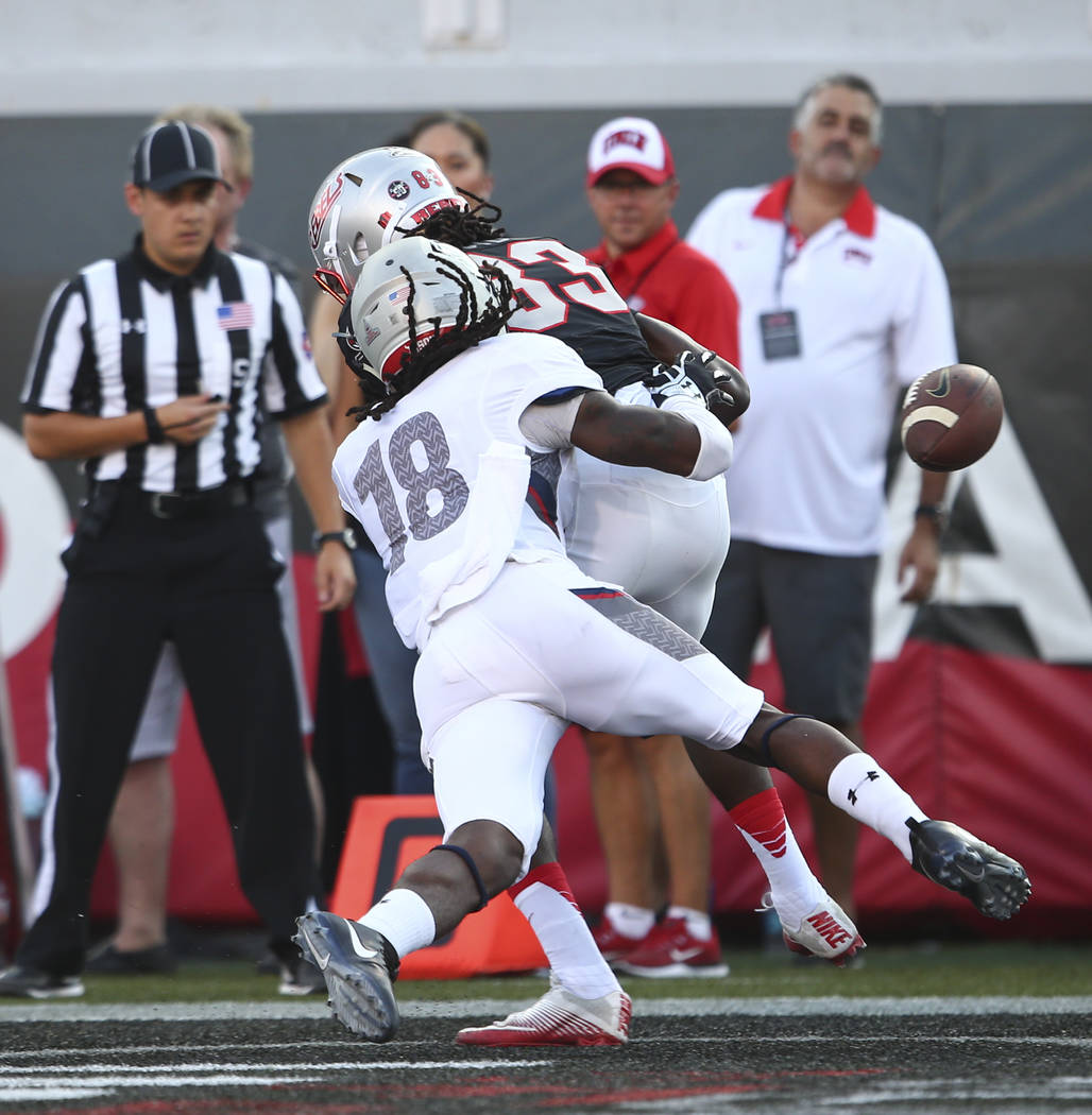 Howard defensive back Travon Hunt (18) breaks up a pass intended for UNLV wide receiver Devonte Boyd (83) during a football game at Sam Boyd Stadium in Las Vegas on Saturday, Sept. 2, 2017. Chase  ...