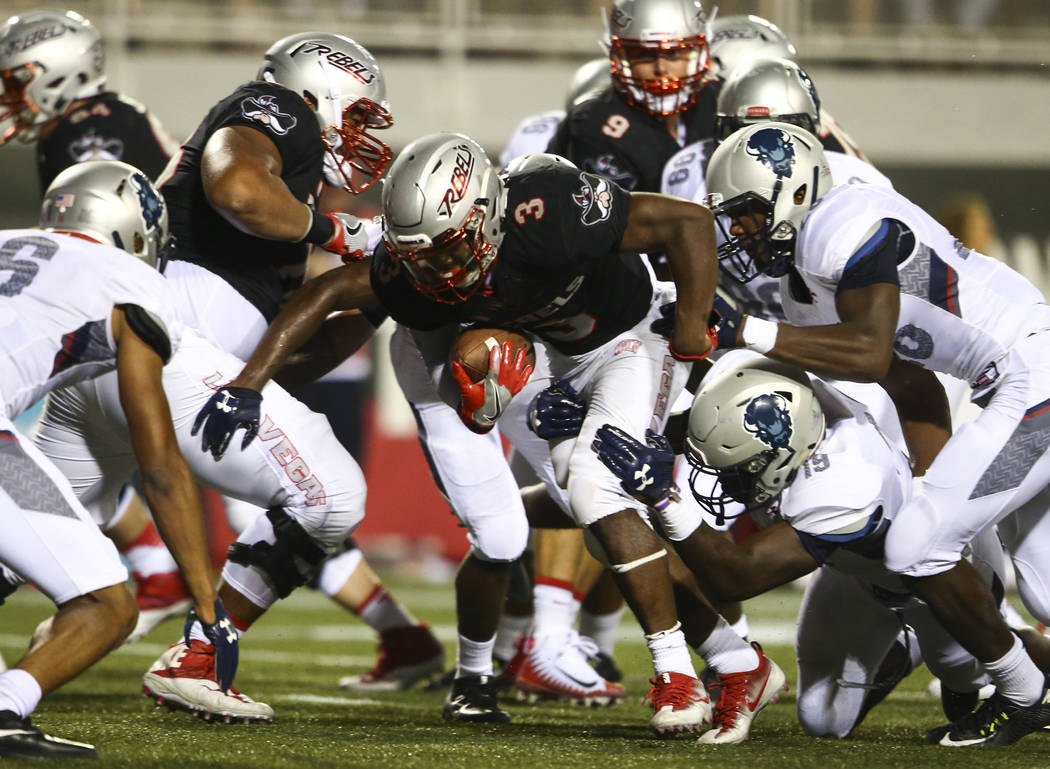 UNLV running back Lexington Thomas (3) is tackled by Howard defense during a football game at Sam Boyd Stadium in Las Vegas on Saturday, Sept. 2, 2017. Chase Stevens Las Vegas Review-Journal @csst ...