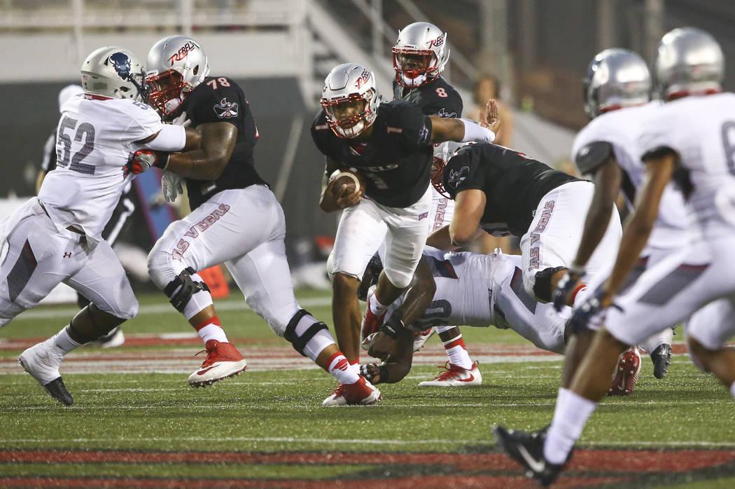 UNLV quarterback Armani Rogers (1) runs the ball against Howard during a football game at Sam Boyd Stadium in Las Vegas on Saturday, Sept. 2, 2017. Chase Stevens Las Vegas Review-Journal @cssteven ...