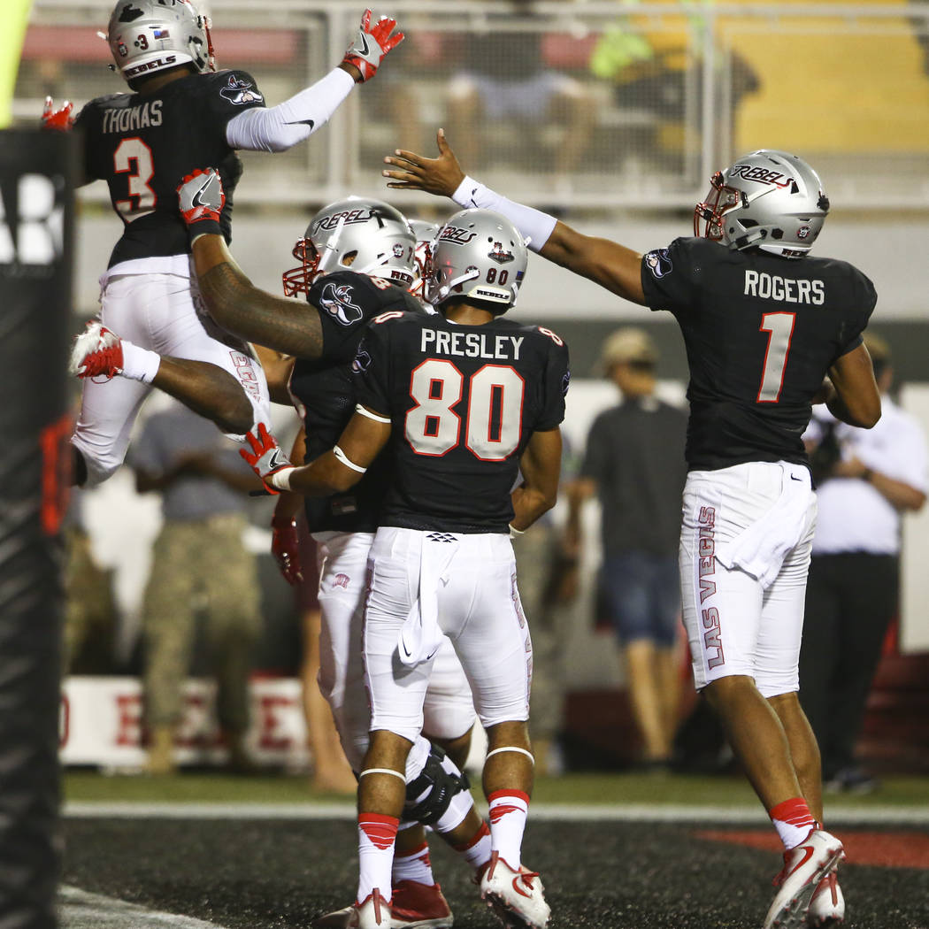 UNLV running back Lexington Thomas (3) celebrates a touchdown over Howard during a football game at Sam Boyd Stadium in Las Vegas on Saturday, Sept. 2, 2017. Chase Stevens Las Vegas Review-Journal ...