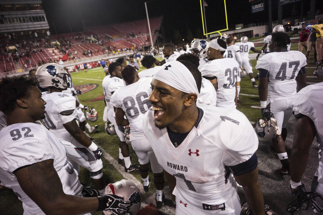 Howard's Guy Lemonier Jr. celebrates with teammates after defeating UNLV 43-40 during a football game at Sam Boyd Stadium in Las Vegas on Saturday, Sept. 2, 2017. Chase Stevens Las Vegas Review-Jo ...