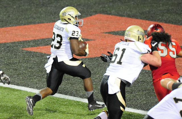 Idaho Vandals running back Aaron Duckworth (23) scores a touchdown against UNLV in the first half of their NCAA college football game at Sam Boyd Stadium in Henderson Saturday, Sept. 24, 2016. Jos ...