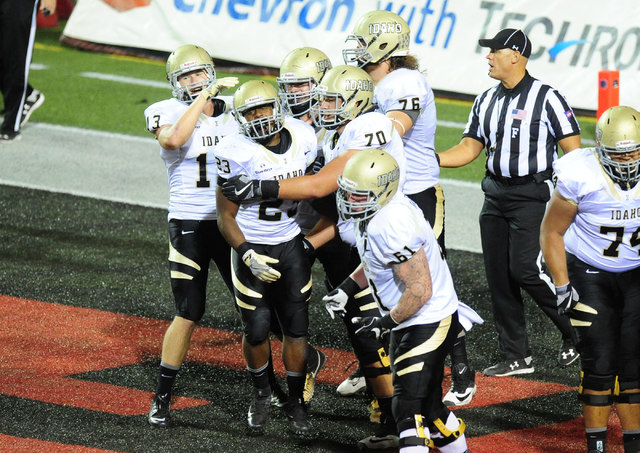 Idaho Vandals players celebrate after running back Aaron Duckworth, middle, scored a touchdown against UNLV in the first half of their NCAA college football game at Sam Boyd Stadium in Henderson S ...