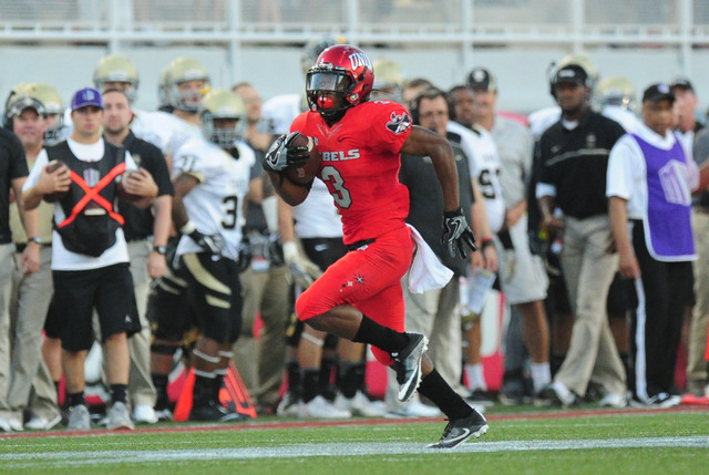 UNLV Rebels running back Lexington Thomas (3) rushes for a first down against Idaho in the first half of their NCAA college football game at Sam Boyd Stadium in Henderson Saturday, Sept. 24, 2016. ...