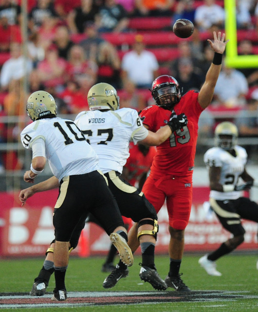 UNLV Rebels defensive lineman Mark Finau (19) nearly intercepts an Idaho Vandals pass thrown by quarterback Matt Linehan (10) in the first half of their NCAA college football game at Sam Boyd Stad ...