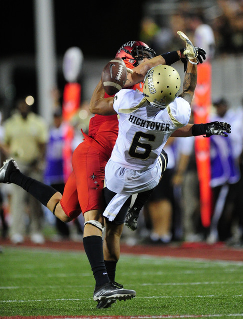 UNLV Rebels defensive back Troy Hawthorne (11) breaks up a pass intended for Idaho Vandals wide receiver Callen Hightower (6) in the fourth quarter of their NCAA college football game at Sam Boyd  ...