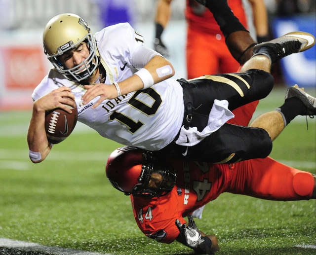 Idaho Vandals quarterback Matt Linehan (10) dives into the endzone to score a touchdown as UNLV Rebels defensive back Kenny Keys (44) defends late in the fourth quarter of their NCAA college footb ...