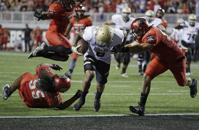 Idaho wide receiver Callen Hightower scores against UNLV in overtime of an NCAA college football game Saturday, Sept. 24, 2016, in Las Vegas. Idaho won 33-30. (AP Photo/John Locher)
