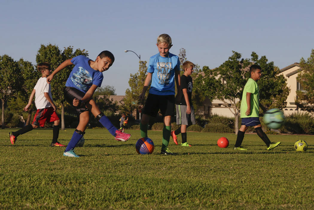 Members of the U-12 boy's team, The Dragons, who are a part of the Southern Nevada Soccer Association, practice in the corner of Inzalaco Park in Las Vegas, on Thursday, Aug. 24, 2017.  Gabriella  ...