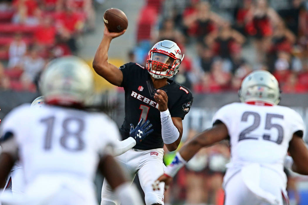 UNLV quarterback Armani Rogers (1) makes a pass against Howard's Travon Hunt (18) and Leland Lassiter (25) during a football game at Sam Boyd Stadium in Las Vegas on Saturday, Sept. 2, 2017. Chase ...