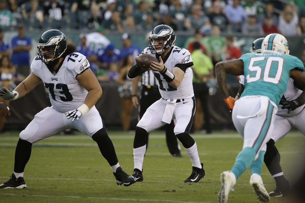 Philadelphia Eagles' Carson Wentz in action during the first half of a preseason NFL football game against the Miami Dolphins, Thursday, Aug. 24, 2017, in Philadelphia. (AP Photo/Matt Rourke)