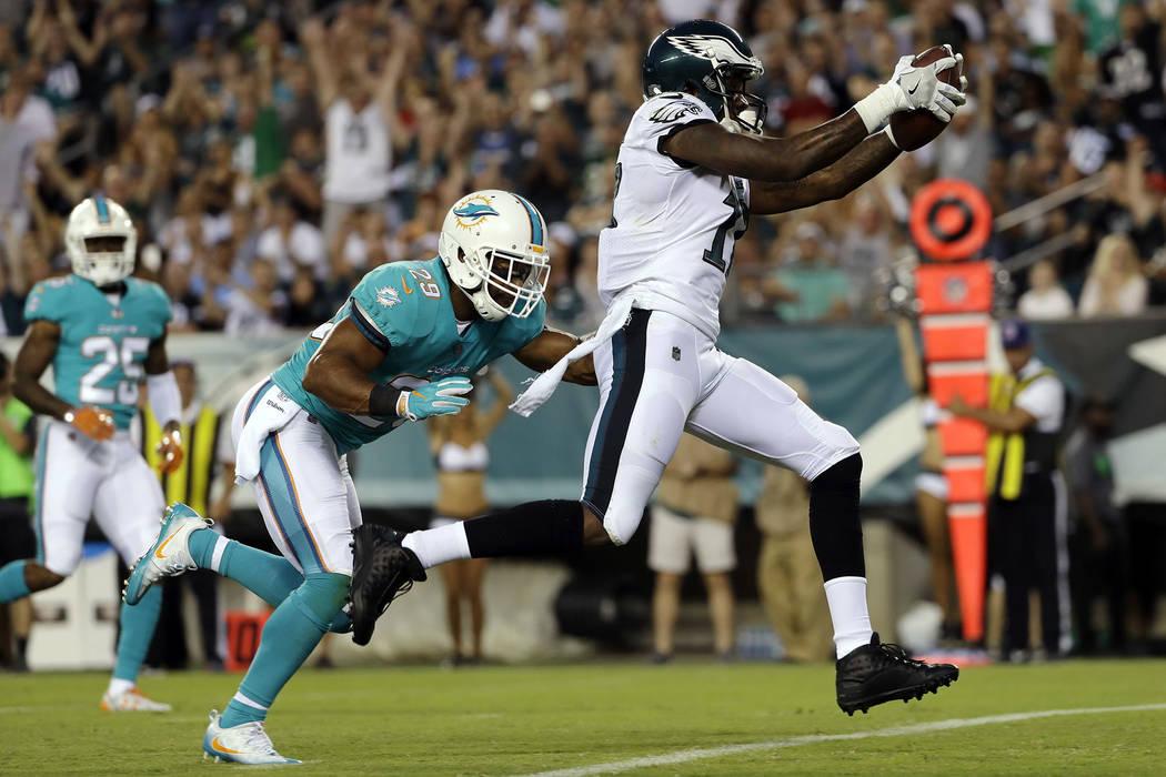 Philadelphia Eagles' Alshon Jeffery, right, scores a touchdown past Miami Dolphins' Nate Allen during the first half of a preseason NFL football game, Thursday, Aug. 24, 2017, in Philadelphia. (AP ...