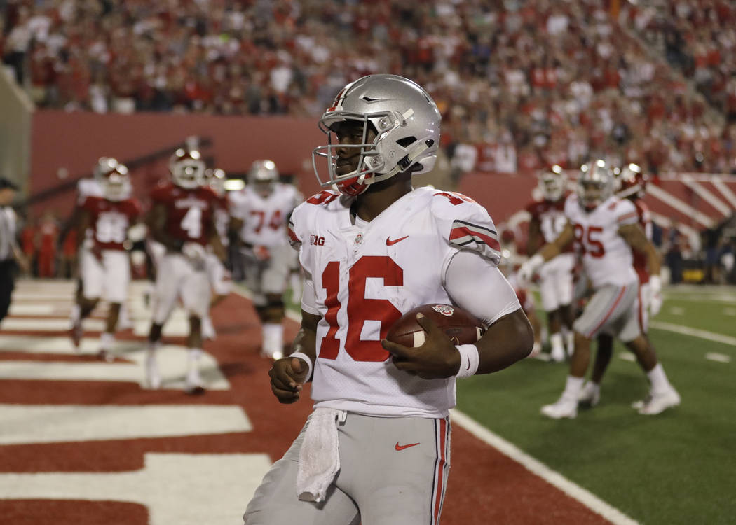 Ohio State quarterback J.T. Barrett (16) runs during the second half of an NCAA college football game against Indiana, Thursday, Aug. 31, 2017, in Bloomington, Ind. (AP Photo/Darron Cummings)