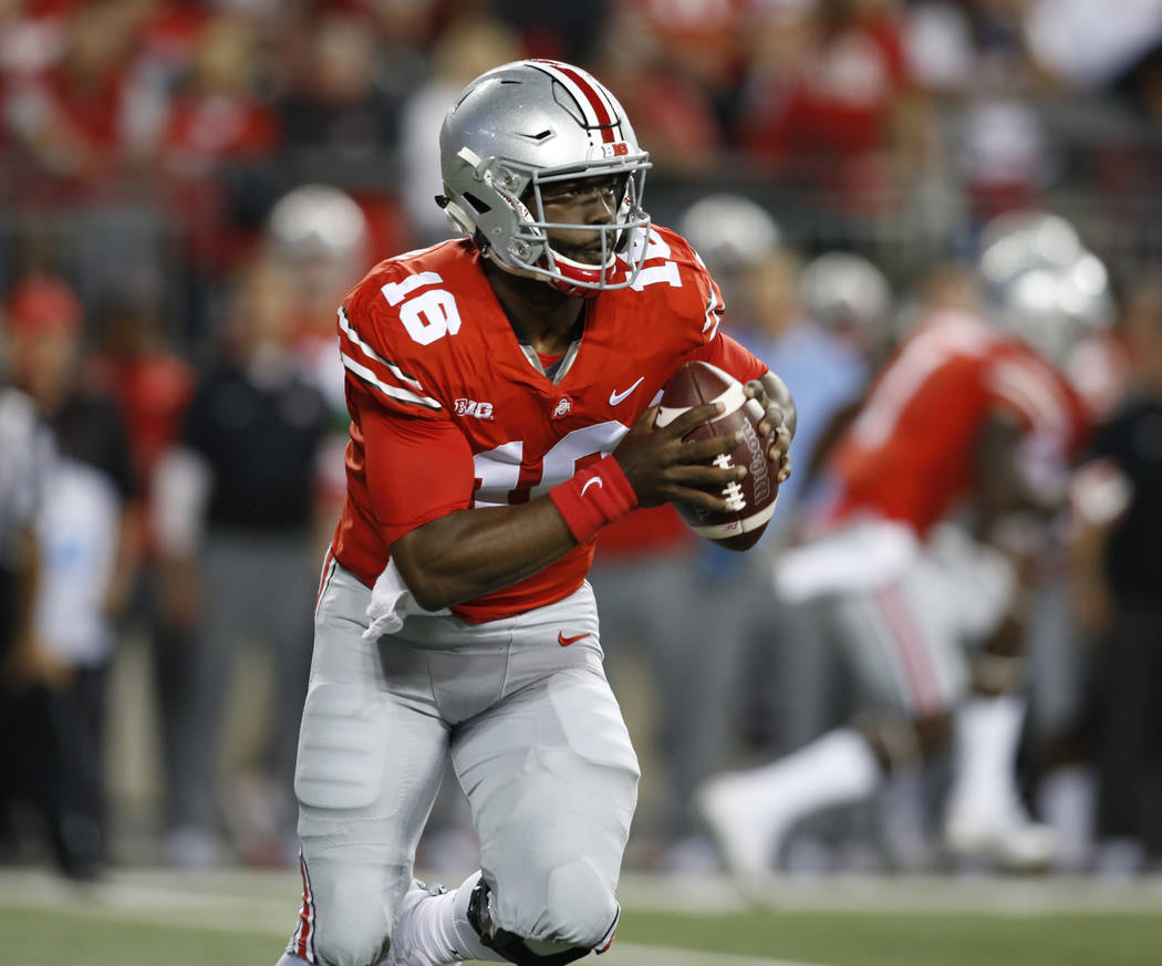 Ohio State quarterback J.T. Barrett runs against Oklahoma during an NCAA college football game Saturday, Sept. 10, 2017, in Columbus, Ohio. Oklahoma won 31-16. (AP Photo/Paul Vernon)