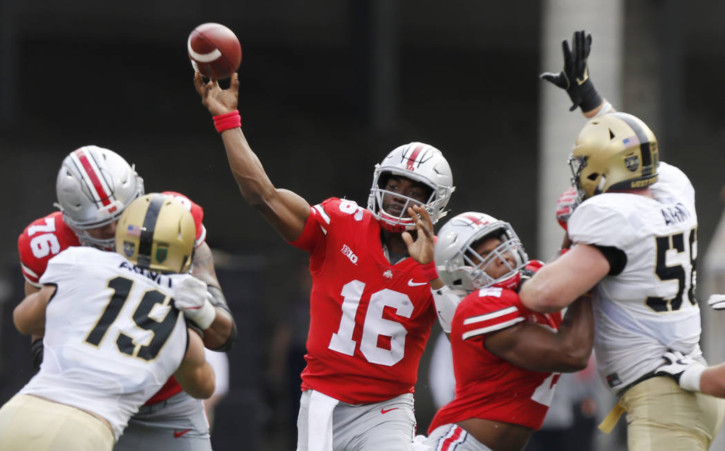 Ohio State quarterback J.T. Barrett throws a pass against Army during the first half of an NCAA college football game, Saturday, Sept. 16, 2017, in Columbus, Ohio. Ohio State defeated Army 38-7. ( ...