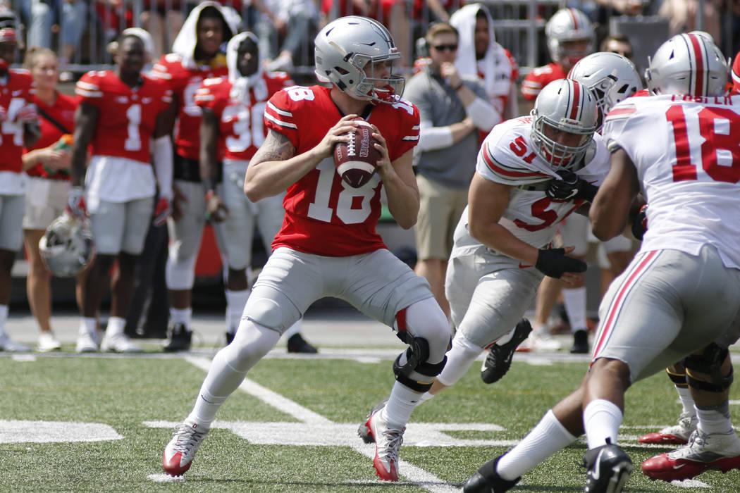 Ohio State quarterback Tate Martell plays in their NCAA college spring football game Saturday, April 15, 2017, in Columbus, Ohio. (AP Photo/Jay LaPrete)