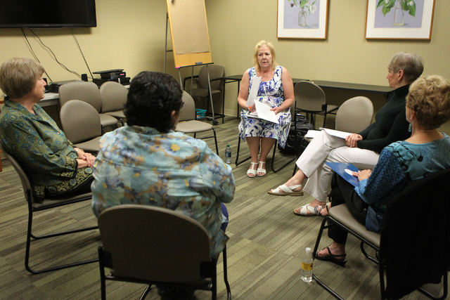 Laurie Moore Moss, center, peer counseling coordinator for the St. Rose Dominican Hospitals, speaks to fellow counselors during a meeting at the Barbara Greenspun WomensCare Center of Excellence i ...