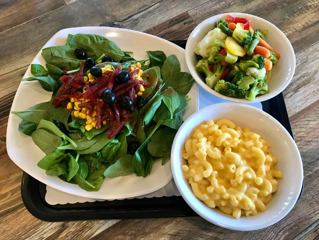 A large side salad and two large sides accompany every order of a whole rotisserie chicken ($26). Clockwise: Large spinach salad, steamed vegetables and macaroni and cheese. (Madelyn Reese/View) @ ...