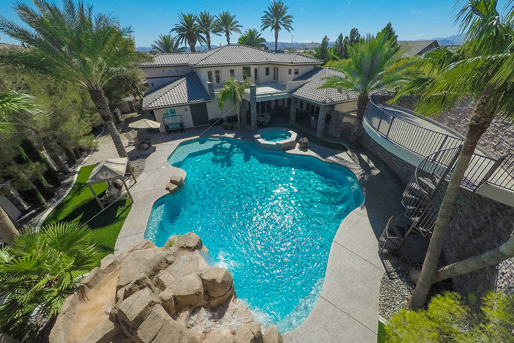 After George and Mimi Murdock's sons started jumping from the upper deck of the home into the deep lagoon-style pool, the couple installed a zip line. (Rob Jensen Co.)