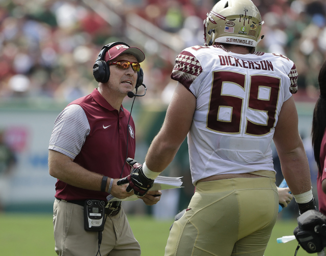 Florida State head coach Jimbo Fisher, left, talks to offensive lineman Landon Dickerson (69) during the first quarter of an NCAA college football game against South Florida Saturday, Sept. 24, 20 ...