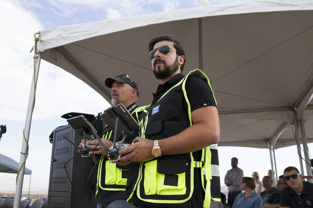 Jeff Scholl, left, chief technology officer for Quadrocopter, and Edward Kostakis, senior pilot for DJI, during a demonstration of the DJI Matrice 200 drone at the Henderson Unmanned Vehicle Range ...