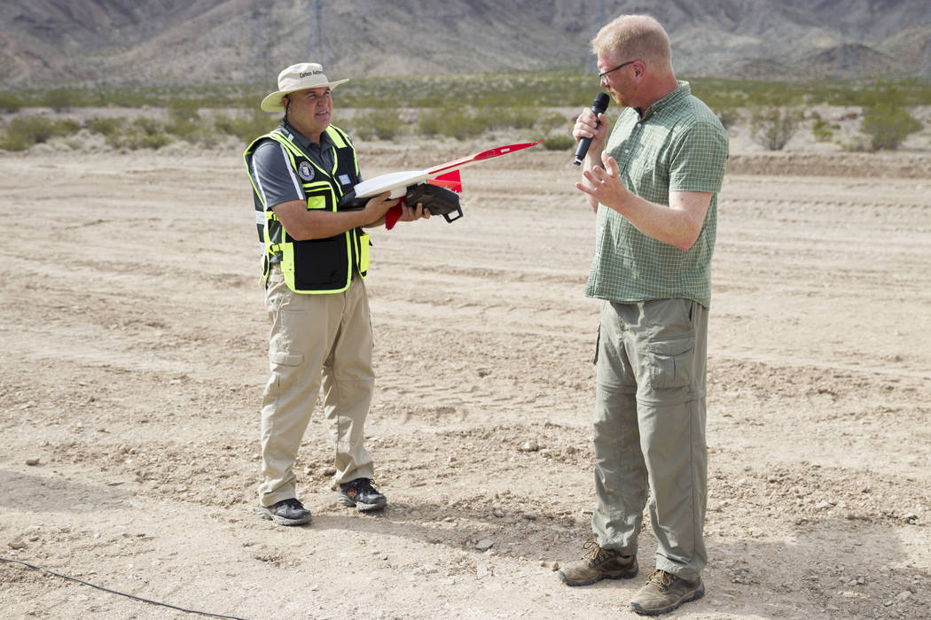 John Hammond, left, chief pilot and director of safety and training for SmartPlanes, and Roger Ohlund, chief marketing officer, during a demonstration of their unmanned aircraft systems, at the He ...