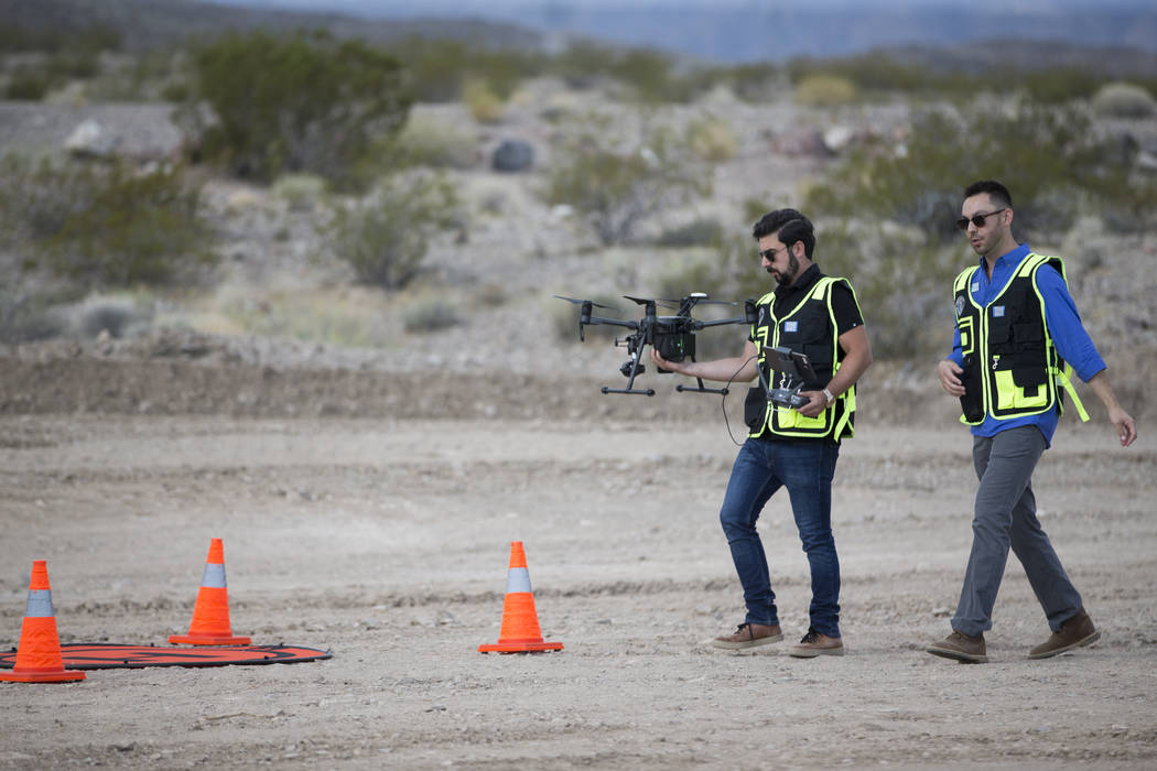 Edward Kostakis, left, senior pilot for DJI, during a demonstration of the DJI Matrice 200 drone at the Henderson Unmanned Vehicle Range in Henderson, Tuesday, Sept. 5, 2017. (Erik Verduzco/Las Ve ...