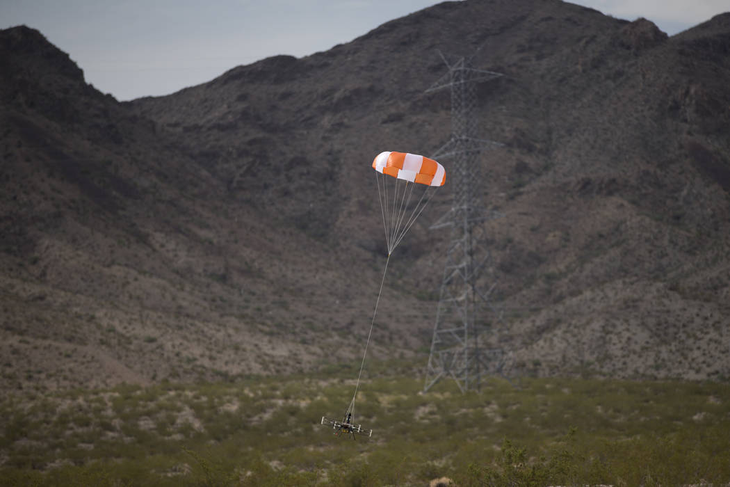 A parachute recovery system demonstration by Gene Engelgau, not pictured, CEO of Fruity Chutes, at the Henderson Unmanned Vehicle Range in Henderson, Tuesday, Sept. 5, 2017. (Erik Verduzco/Las Veg ...