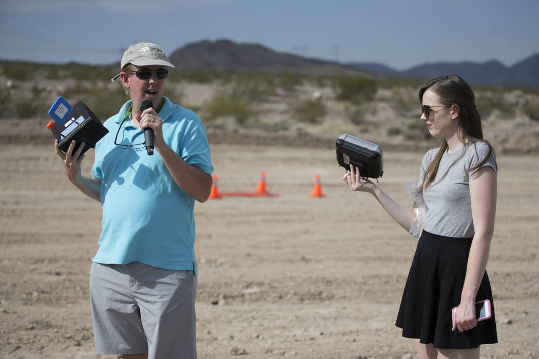 Gene Engelgau, left, CEO of Fruity Chutes, and his daughter Janice, give a demonstration of their parachute recovery system of unmanned aircraft systems, at the Henderson Unmanned Vehicle Range in ...