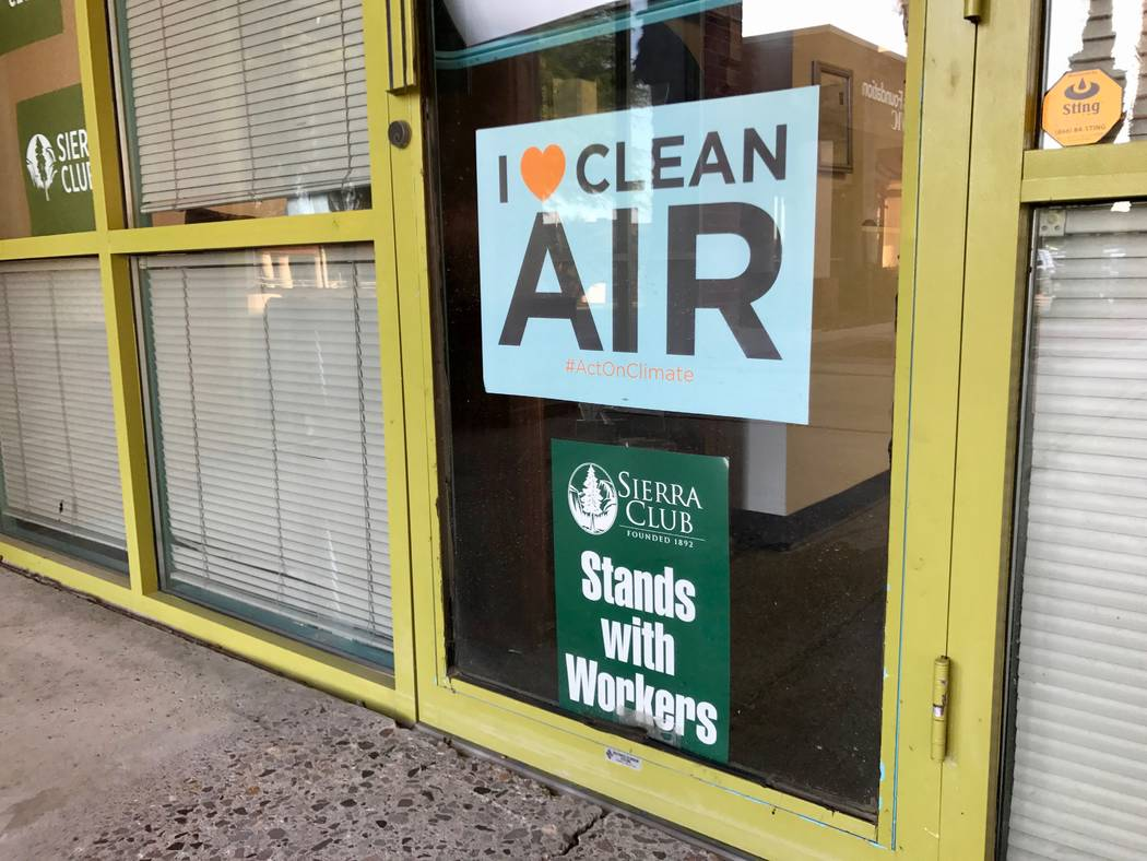 Advocacy signs hang in the window of the Sierra Club Southern Nevada Group's new offices on Meadows Lane on Aug. 24, 2017.(Madelyn Reese/View) @MadelynGReese