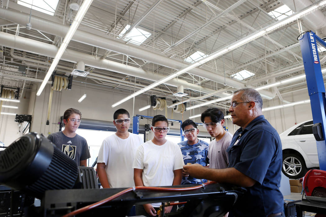 Tony Centro, right, instructs his students during their welding and  mechanical technology class at