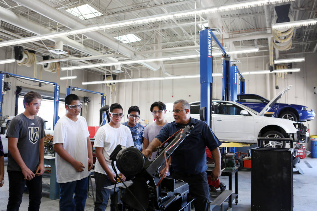 Tony Centro, right, instructs his students during their welding and mechanical technology class at East Career and Technical Academy in Las Vegas, Monday, Aug. 28, 2017. Elizabeth Brumley Las Vega ...