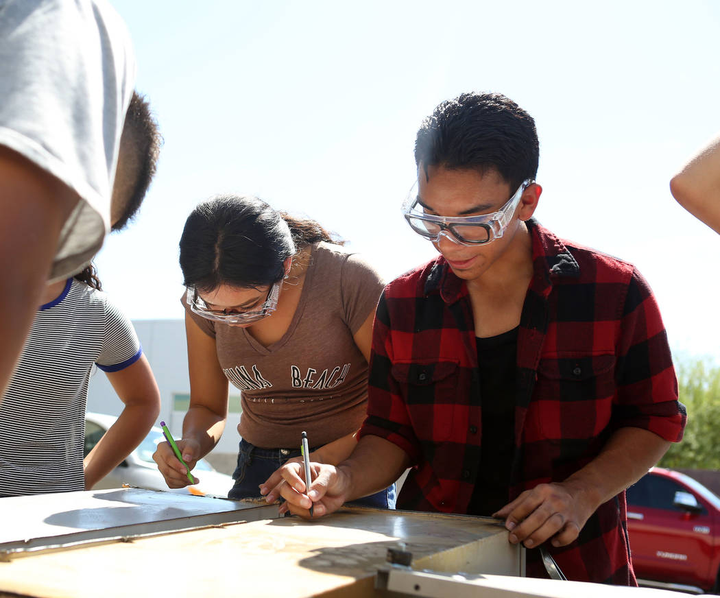 Jacquelin Silva, 16, left, and Matthew Lopez, 15, draw on metal during their welding and mechanical technology class at East Career and Technical Academy in Las Vegas, Monday, Aug. 28, 2017. Eliza ...