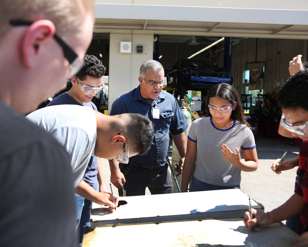 Tony Centro, center, instructs his students during their welding and mechanical technology class at East Career and Technical Academy in Las Vegas, Monday, Aug. 28, 2017. Elizabeth Brumley Las Veg ...