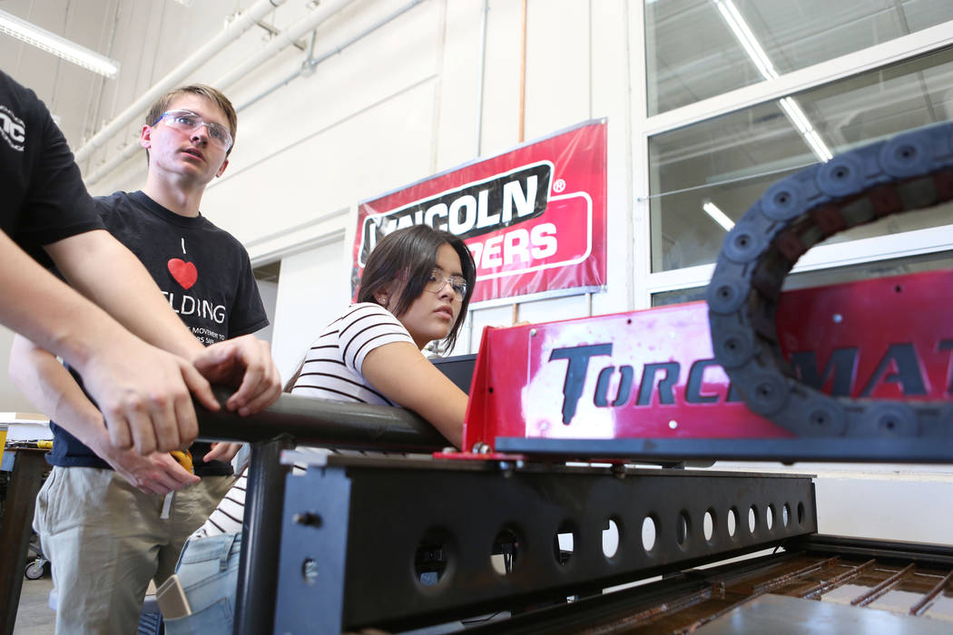 Students John Berdahl, 17, left, and Melanie Lopez, 17,  work during their welding and mechanical technology class at East Career and Technical Academy in Las Vegas, Monday, Aug. 28, 2017. Elizabe ...