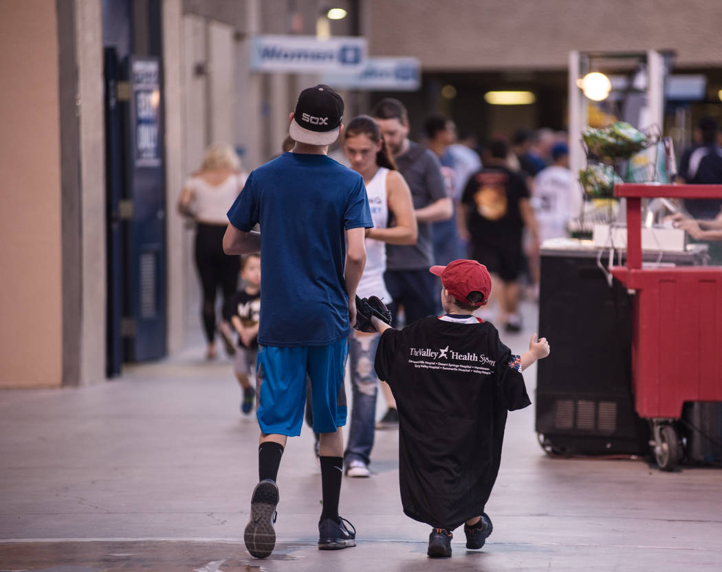 A pair of boys head to a concessions stand at Cashman Field on Saturday, Sep. 2, 2017, in Las Vegas. Morgan Lieberman Las Vegas Review-Journal