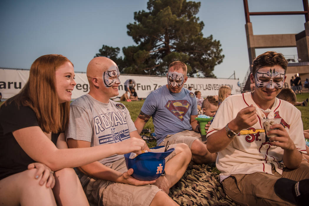 Ashley Ryle, from left, Corle Ryle, Lance Meehan, and Levi Chamberlain enjoy the baseball game from the grass at Cashman Field on Saturday, Sep. 2, 2017, in Las Vegas. Morgan Lieberman Las Vegas R ...