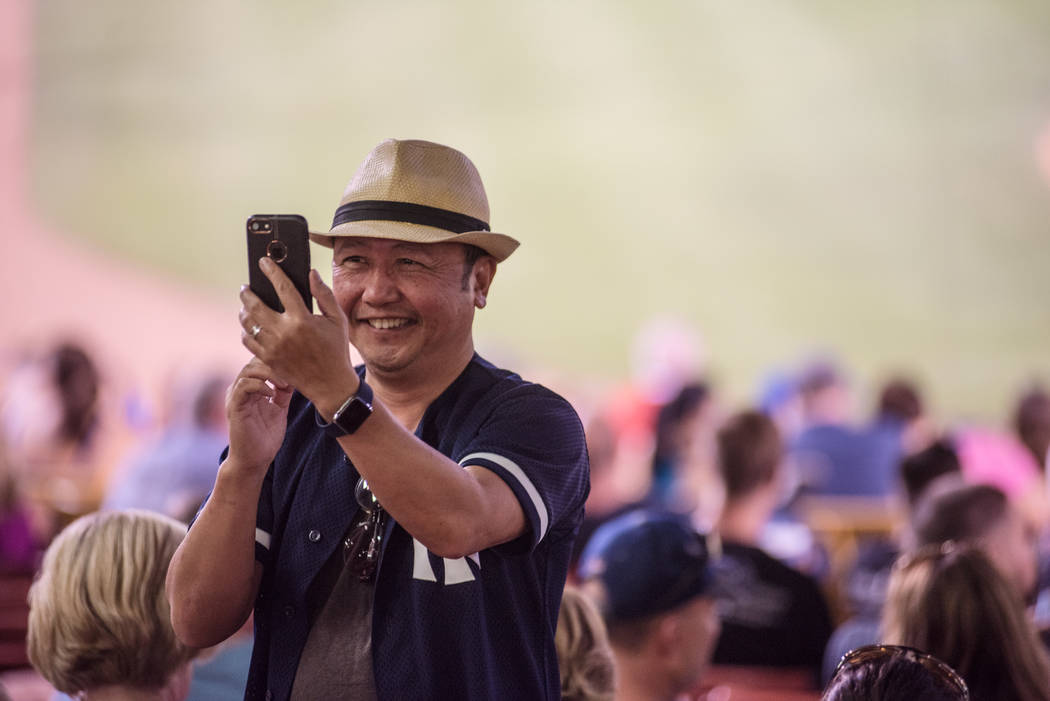 Alan Galinato takes a phone call during the game at Cashman Field on Saturday, Sep. 2, 2017, in Las Vegas. Morgan Lieberman Las Vegas Review-Journal
