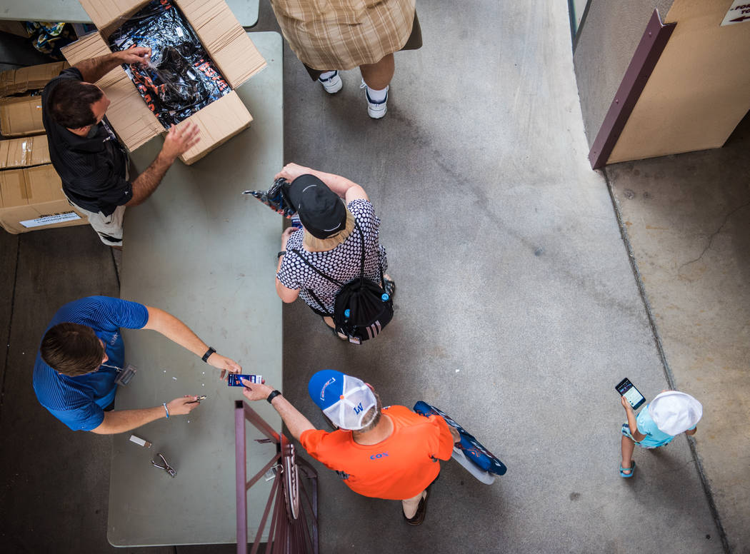 Attendees at the entrance of Cashman Field received free T-shirts on Saturday, Sep. 2, 2017, in Las Vegas. Morgan Lieberman Las Vegas Review-Journal