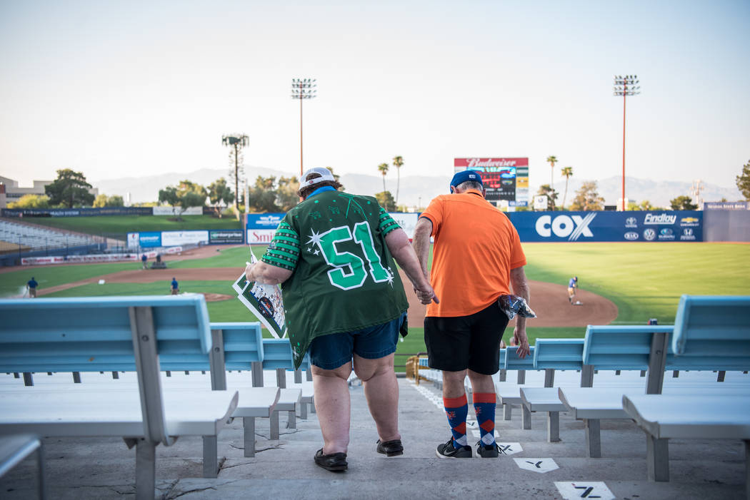 Two attendees make their way to their seats  at Cashman Field on Saturday, Sep. 2, 2017, in Las Vegas. Morgan Lieberman Las Vegas Review-Journal