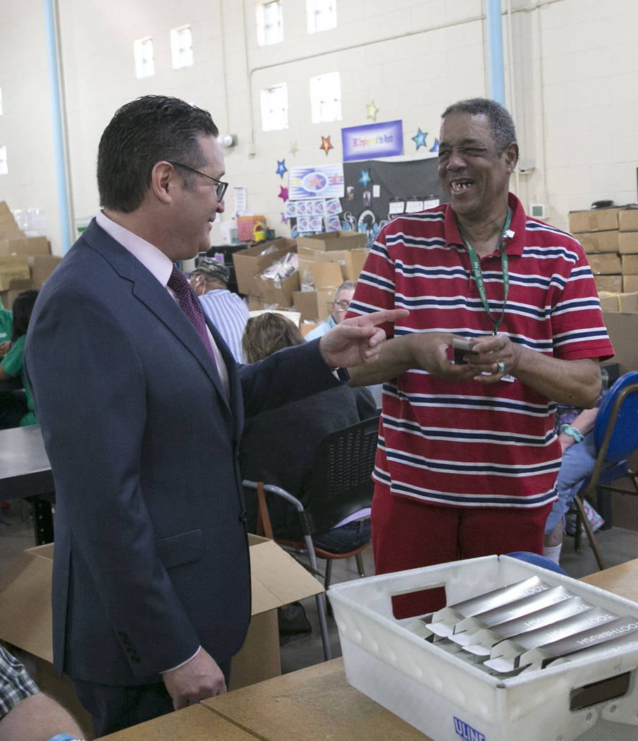 Opportunity Village's Vice President of Philanthropy, Adam Joseph, left, chats with Ronnie H., at Opportunity Village on   Wednesday, Aug. 30, 2017, in Las Vegas. (Bizuayehu Tesfaye/Las Vegas Revi ...