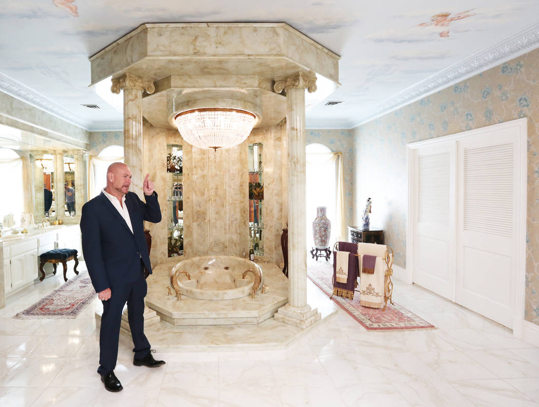 Martyn Ravenhill, owner of the Liberace Mansion, points out features of the master bathroom on Monday, Aug 28, 2017, in Las Vegas. Benjamin Hager Las Vegas Review-Journal @benjaminhphoto