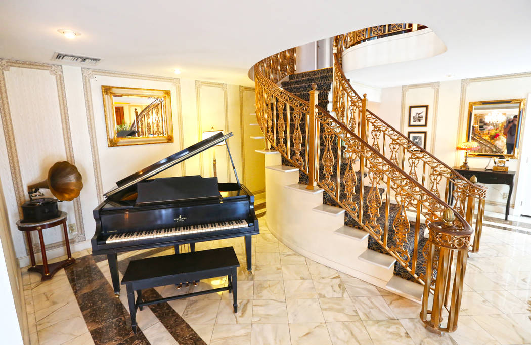 One of nine pianos and a curved staircase from a can-can bar in Paris in the entryway of the Liberace Mansion on Monday, Aug 28, 2017, in Las Vegas. Benjamin Hager Las Vegas Review-Journal @benjam ...