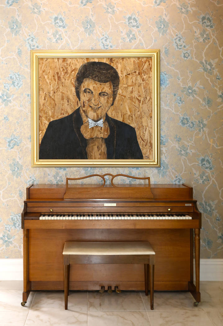 A painting of Liberace hangs over one of nine pianos in the Liberace Mansion on Monday, Aug 28, 2017, in Las Vegas. Benjamin Hager Las Vegas Review-Journal @benjaminhphoto