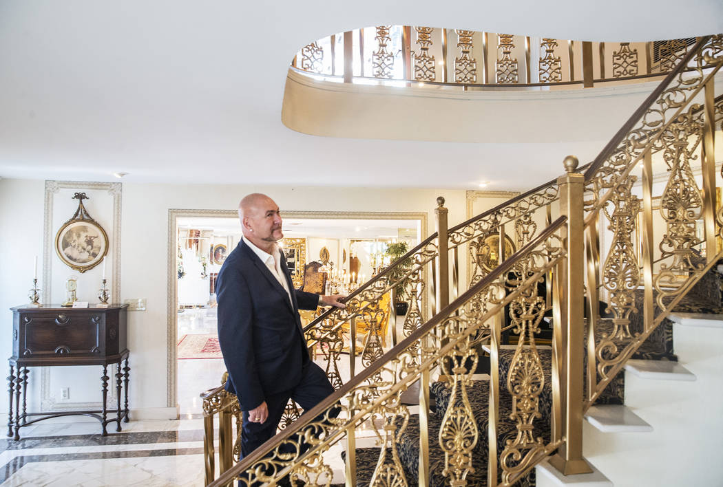 Martyn Ravenhill, owner of the Liberace Mansion, walks up a curved staircase from a can-can bar in Paris that now occupies the entryway of the 15,000 square foot historic property on Monday, Aug 2 ...