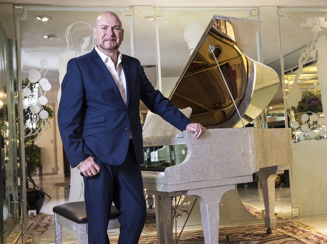 Martyn Ravenhill, owner of the Liberace Mansion, with one of nine pianos at the historic Las Vegas property on Monday, Aug 28, 2017. Benjamin Hager Las Vegas Review-Journal @benjaminhphoto