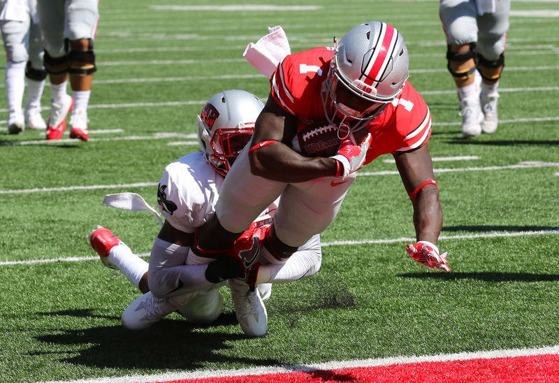 Sep 23, 2017; Columbus, OH, USA; Ohio State Buckeyes wide receiver Johnnie Dixon (1) scores a touchdown on a pass during the first quarter against the UNLV Rebels at Ohio Stadium. Mandatory Credit ...
